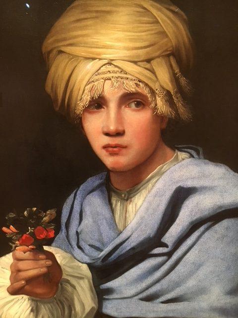 Jongen met tulband en ruiker